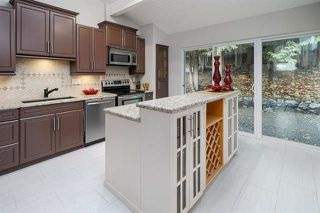 """Photo 8: 2615 CHARTER HILL Place in Coquitlam: Upper Eagle Ridge House for sale in """"UPPER EAGLE RIDGE"""" : MLS®# R2231205"""