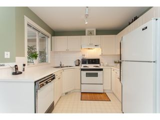 "Photo 7: 406 13900 HYLAND Road in Surrey: East Newton Townhouse for sale in ""Hyland Grove"" : MLS®# R2240746"