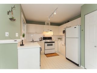 "Photo 6: 406 13900 HYLAND Road in Surrey: East Newton Townhouse for sale in ""Hyland Grove"" : MLS®# R2240746"