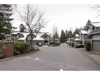 "Photo 2: 406 13900 HYLAND Road in Surrey: East Newton Townhouse for sale in ""Hyland Grove"" : MLS®# R2240746"
