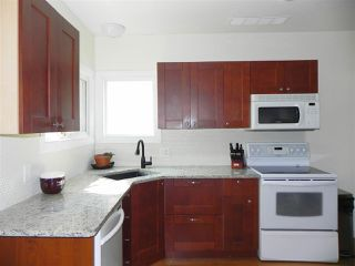 Photo 2: 7415 112 Avenue in Edmonton: Zone 09 House for sale : MLS®# E4148011