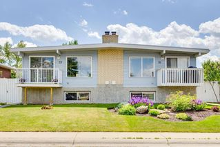 Photo 2: 72 QUEEN ISABELLA Close SE in Calgary: Queensland Semi Detached for sale : MLS®# C4254549