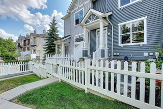 Photo 2: 160 ELGIN Gardens SE in Calgary: McKenzie Towne Row/Townhouse for sale : MLS®# A1017963