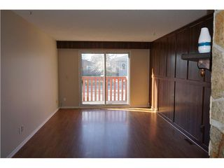 Photo 2: B 1320 36 Street SE in Calgary: Forest Lawn Residential Attached for sale : MLS®# C3641684