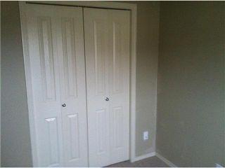 Photo 10: 26 SADDLEBROOK Point NE in Calgary: Saddleridge Townhouse for sale : MLS®# C3544638