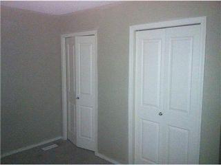 Photo 5: 26 SADDLEBROOK Point NE in Calgary: Saddleridge Townhouse for sale : MLS®# C3544638