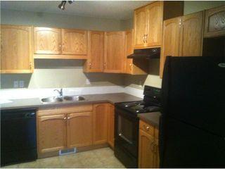 Photo 3: 26 SADDLEBROOK Point NE in Calgary: Saddleridge Townhouse for sale : MLS®# C3544638