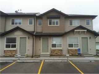 Photo 1: 26 SADDLEBROOK Point NE in Calgary: Saddleridge Townhouse for sale : MLS®# C3544638
