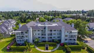 Photo 1: 306 13680 84 Avenue in Surrey: Bear Creek Green Timbers Condo for sale : MLS®# R2308360
