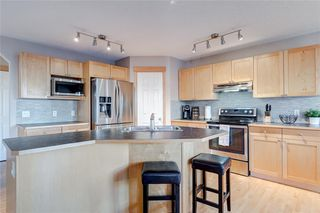 Photo 13: 217 TUSCANY MEADOWS Heights NW in Calgary: Tuscany Detached for sale : MLS®# C4213768