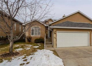 Photo 1: 356 SIGNATURE Court SW in Calgary: Signal Hill Semi Detached for sale : MLS®# C4220141