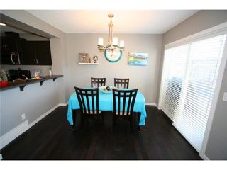 Photo 9: 225 SUNSET Common: Cochrane Residential Attached for sale : MLS®# C3590396