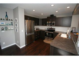 Photo 4: 225 SUNSET Common: Cochrane Residential Attached for sale : MLS®# C3590396