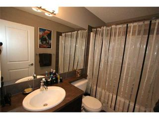 Photo 15: 225 SUNSET Common: Cochrane Residential Attached for sale : MLS®# C3590396