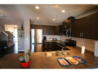 Photo 5: 225 SUNSET Common: Cochrane Residential Attached for sale : MLS®# C3590396
