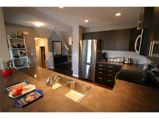 Photo 6: 225 SUNSET Common: Cochrane Residential Attached for sale : MLS®# C3590396