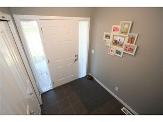 Photo 2: 225 SUNSET Common: Cochrane Residential Attached for sale : MLS®# C3590396