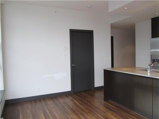 "Photo 6: 404 1088 W 14TH Avenue in Vancouver: Fairview VW Condo for sale in ""COCO"" (Vancouver West)  : MLS®# V1044068"