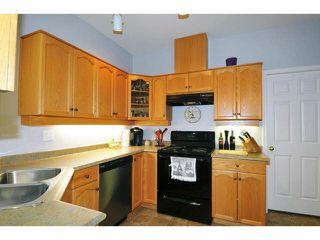 "Photo 3: 407 12464 191B Street in Pitt Meadows: Mid Meadows Condo for sale in ""LASEUR MANOR"" : MLS®# V1127301"