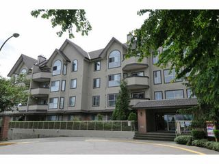 "Photo 1: 407 12464 191B Street in Pitt Meadows: Mid Meadows Condo for sale in ""LASEUR MANOR"" : MLS®# V1127301"