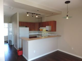 "Photo 3: 404 20200 56 Avenue in Langley: Langley City Condo for sale in ""The Bentley"" : MLS®# R2049956"