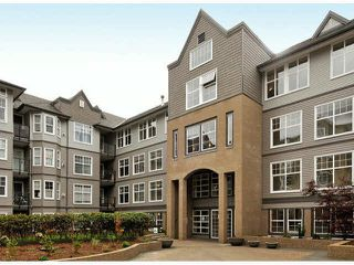 "Photo 1: 404 20200 56 Avenue in Langley: Langley City Condo for sale in ""The Bentley"" : MLS®# R2049956"