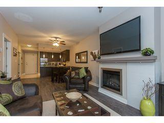 "Photo 4: 103 2368 MARPOLE Avenue in Port Coquitlam: Central Pt Coquitlam Condo for sale in ""RIVER ROCK LANDING"" : MLS®# R2156239"