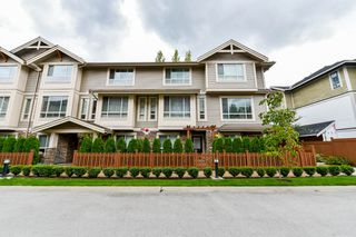 "Photo 1: 32 19752 55A Avenue in Langley: Langley City Townhouse for sale in ""Marquee"" : MLS®# R2334999"