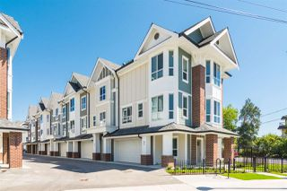 Photo 1: 11 20723 FRASER Highway in Langley: Langley City Townhouse for sale : MLS®# R2377585