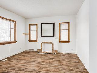 Photo 8: 217 24 Avenue NE in Calgary: Tuxedo Park Detached for sale : MLS®# A1054572