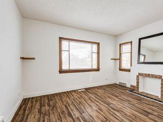 Photo 9: 217 24 Avenue NE in Calgary: Tuxedo Park Detached for sale : MLS®# A1054572