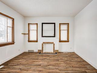 Photo 7: 217 24 Avenue NE in Calgary: Tuxedo Park Detached for sale : MLS®# A1054572