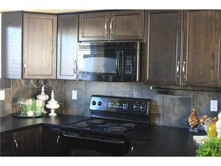 Photo 12: 176 EVERSYDE Boulevard SW in CALGARY: Evergreen Residential Attached for sale (Calgary)  : MLS®# C3543318