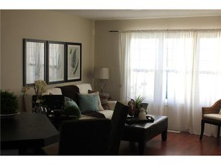 Photo 4: 176 EVERSYDE Boulevard SW in CALGARY: Evergreen Residential Attached for sale (Calgary)  : MLS®# C3543318
