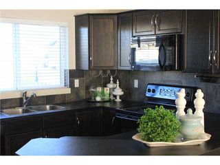Photo 13: 176 EVERSYDE Boulevard SW in CALGARY: Evergreen Residential Attached for sale (Calgary)  : MLS®# C3543318