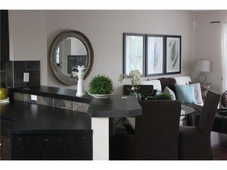 Photo 6: 176 EVERSYDE Boulevard SW in CALGARY: Evergreen Residential Attached for sale (Calgary)  : MLS®# C3543318