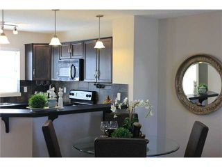Photo 9: 176 EVERSYDE Boulevard SW in CALGARY: Evergreen Residential Attached for sale (Calgary)  : MLS®# C3543318