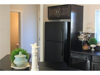 Photo 14: 176 EVERSYDE Boulevard SW in CALGARY: Evergreen Residential Attached for sale (Calgary)  : MLS®# C3543318