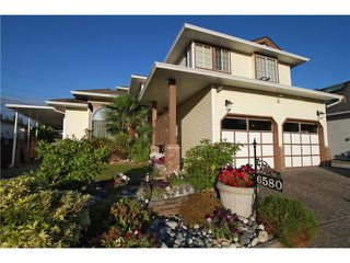 Photo 1: 6580 179TH Street in Surrey: Cloverdale BC House for sale (Cloverdale)  : MLS®# F1415629