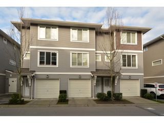 "Photo 1: 34 15155 62A Avenue in Surrey: Sullivan Station Townhouse for sale in ""Oaklands in Panorama Place"" : MLS®# F1431470"