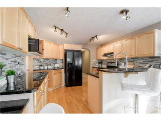 Photo 11: 69 STRATHLEA Place SW in Calgary: Strathcona Park House for sale : MLS®# C4101174