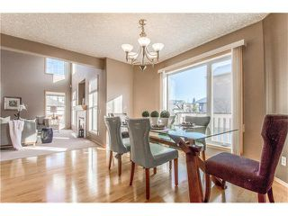 Photo 9: 69 STRATHLEA Place SW in Calgary: Strathcona Park House for sale : MLS®# C4101174