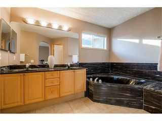 Photo 23: 69 STRATHLEA Place SW in Calgary: Strathcona Park House for sale : MLS®# C4101174