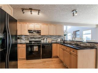 Photo 13: 69 STRATHLEA Place SW in Calgary: Strathcona Park House for sale : MLS®# C4101174