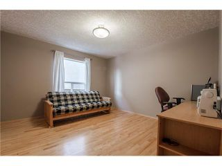 Photo 16: 69 STRATHLEA Place SW in Calgary: Strathcona Park House for sale : MLS®# C4101174