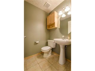 Photo 18: 69 STRATHLEA Place SW in Calgary: Strathcona Park House for sale : MLS®# C4101174