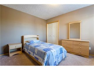 Photo 27: 69 STRATHLEA Place SW in Calgary: Strathcona Park House for sale : MLS®# C4101174
