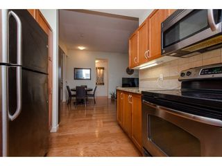 "Photo 11: 408 33328 E BOURQUIN Crescent in Abbotsford: Central Abbotsford Condo for sale in ""Nature's Gate"" : MLS®# R2235279"