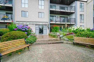 "Photo 2: 211 9952 149 Street in Surrey: Guildford Condo for sale in ""Tall Timbers"" (North Surrey)  : MLS®# R2387203"