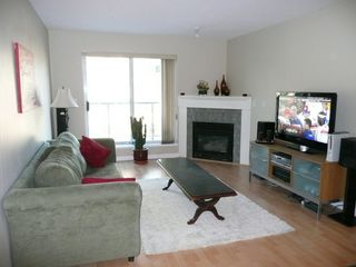 Photo 2: 302 3768 Hastings Street in Burnaby: Home for sale